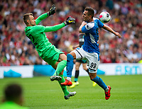 EDINBURGH, SCOTLAND - JULY 28: <br /> Liverpool's Belgian goalkeeper, Simon Mignolet, manages to scramble the ball away from Napoli Centre Forward, Arkadiusz Milik, during the Pre-Season Friendly match between Liverpool FC and SSC Napoli at Murrayfield on July 28, 2019 in Edinburgh, Scotland. (Photo by MB Media)