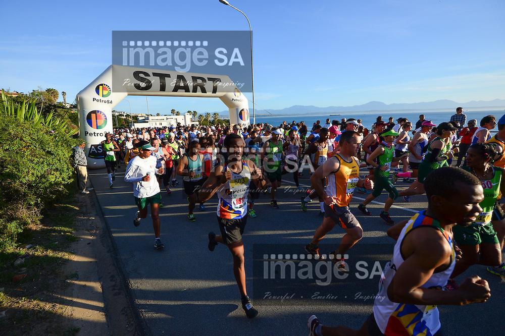 MOSSEL BAY, SOUTH AFRICA - SEPTEMBER 24: athletes at the start of the 21,1km half marathon during the PetroSA Marathon finishing at Santos Caravan Park on September 24, 2016 in Mossel Bay, South Africa. (Photo by Roger Sedres/Gallo Images)