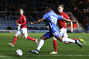 Coventry City midfielder Andy Rose (16) tries to block a Peterborough United forward Shaquile Coulthirst (39) cross during the Sky Bet League 1 match between Peterborough United and Coventry City at London Road, Peterborough, England on 25 March 2016. Photo by Simon Davies.