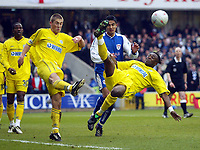 Photo: Scott Heavey.<br />Millwall v Tranmere Rovers. FA Cup 6th Round. 07/03/2004.<br />Eugene Dadi clears the ball fromd danger