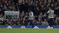 Football - 2016 / 2017 Premier League - Chelsea vs. Middlesborough<br /> <br /> John Terry of Chelsea warms up infront of a banner displayed by an overseas supporter in his honour at Stamford Bridge.<br /> <br /> COLORSPORT/DANIEL BEARHAM