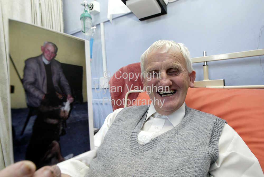 "3/10/2002.John Griffin pictured in St Teresa's Hospital in Clogheen County Tipperary yesterday with a picture of his dog ""Ted""..Picture Dylan Vaughan"