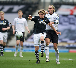 DERBY, ENGLAND - Saturday, March 12, 2011: Swansea City's Joe Allen and Derby County's Robbie Savage during the Football League Championship match at Pride Park. (Photo by David Rawcliffe/Propaganda)