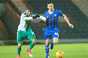 Ian Henderson runs with the ball during the EFL Sky Bet League 1 match between Rochdale and Plymouth Argyle at Spotland, Rochdale, England on 15 December 2018.