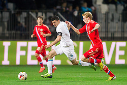 Haris Vuckic of Slovenia vs Pavel Mogilevets of Russia during football match between U21 National Teams of Slovenia and Russia in 6th Round of U21 Euro 2015 Qualifications on November 15, 2013 in Stadium Bonifika, Koper, Slovenia. Photo by Vid Ponikvar / Sportida