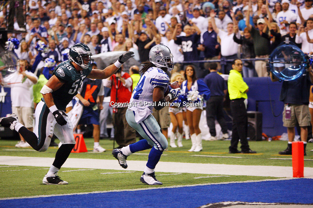 IRVING, TX - SEPTEMBER 15:  Running back Marion Barber of the Dallas Cowboys catches a 17 yard touchdown pass to help the Cowboys take a 31-30 lead in the third quarter while covered by linebacker Stewart Bradley #55 of the Philadelphia Eagles at Texas Stadium on September 15, 2008 in Irving, Texas. The Cowboys defeated the Eagles 41-37. ©Paul Anthony Spinelli *** Local Caption *** Marion Barber;Stewart Bradley