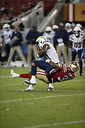 Los Angeles Chargers tight end Je'Ron Hamm (41) and San Francisco 49ers defensive back Antone Exum (38) in action during the 2018 NFL preseason week 4 football game against the San Francisco 49ers on Thursday, Aug. 30, 2018 in Santa Clara, Calif. The Chargers won the game 23-21. (©Paul Anthony Spinelli)