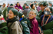 Some Tibetan Pilgrims are waiting to see the Buddha  Maitreya -the Buddha of the future- who is one of the most popular deities in Tibet because he symbolizes the hope of a better life after the reincarnation. The pilgrims often make a  donation of  a katag (white skarf ) and give some banknotes,  in the monastery of  Labrang during the ceremonies of Monlam Chenmo (The Great Prayer) at the beggining of the tibetan year. They come from all the countries around, often after many days of travels. Labrang, province of Gansu, China, March 05 2007.