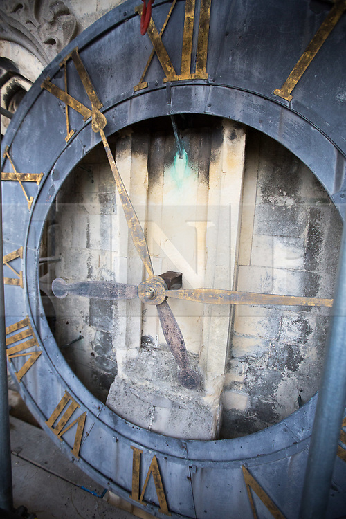 @Licensed to London News Pictures 27/11/2018.Canterbury, Kent. The Cathedral Clock built in 1855  and housed on the south west tower of Canterbury Cathedral is being dismantled ready to be renovated and re-guilded. The clock face weighing 78 kilos and measuring 8 feet in diameter is being shipped to the Cumbrai Clock Company in Penrith and will be absent from the cathedral for 18 months. Photo credit: Manu Palomeque/LNP