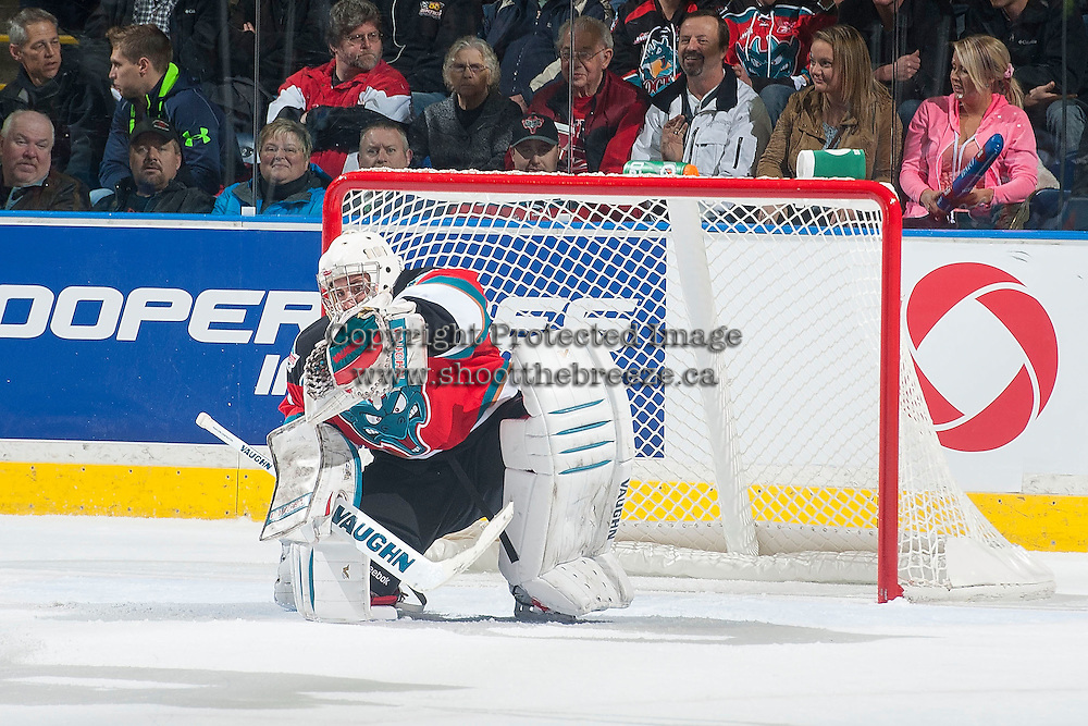 KELOWNA, CANADA - NOVEMBER 21: Jackson Whistle #1 of Kelowna Rockets makes a save against the Portland Winterhawks on November 21, 2014 at Prospera Place in Kelowna, British Columbia, Canada.  (Photo by Marissa Baecker/Shoot the Breeze)  *** Local Caption *** Jackson Whistle;