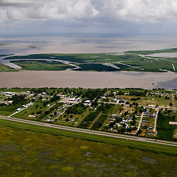 A aerial view of the town of Buras, Louisiana, U.S., on Monday, July 26, 2010. Buras is the home to many fisherman in southern Plaquemines Parish and is still recovering from the impact of Hurricane Katrina, now residents are dealing with the closure of their area fishing grounds. Photographer: Derick E. Hingle