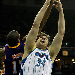 April 24, 2011; New Orleans, LA, USA; New Orleans Hornets center Aaron Gray (34) and Los Angeles Lakers center Andrew Bynum (17) jump for a rebound during the fourth quarter in game four of the first round of the 2011 NBA playoffs at the New Orleans Arena. The Hornets defeated the Lakers 93-88.   Mandatory Credit: Derick E. Hingle