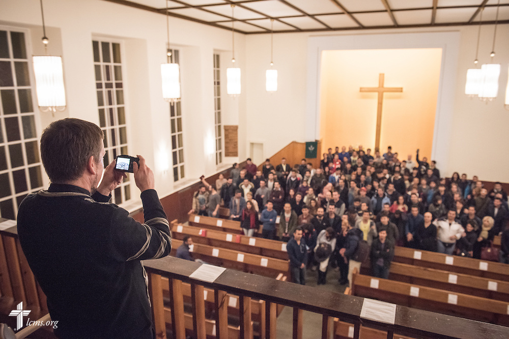 The Rev. Dr. Gottfried Martens takes a group photograph of his Bible study group on Saturday, Nov. 14, 2015, at the Dreieinigkeits-Gemeinde, a SELK Lutheran church in Berlin-Steglitz, Germany.  LCMS Communications/Erik M. Lunsford