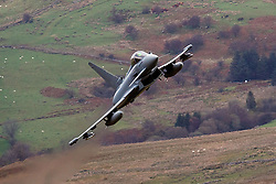 Royal Air Force Eurofighter Typhoon FGR4 flies low level through the Mach Loop, Machynlleth, Wales, United Kingdom