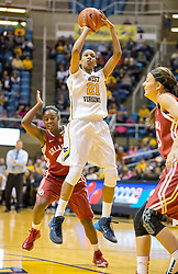 West Virginia Mountaineers guard Jessica Morton (21) shoots a jumper against the Oklahoma Sooners during the first half at the WVU Coliseum.