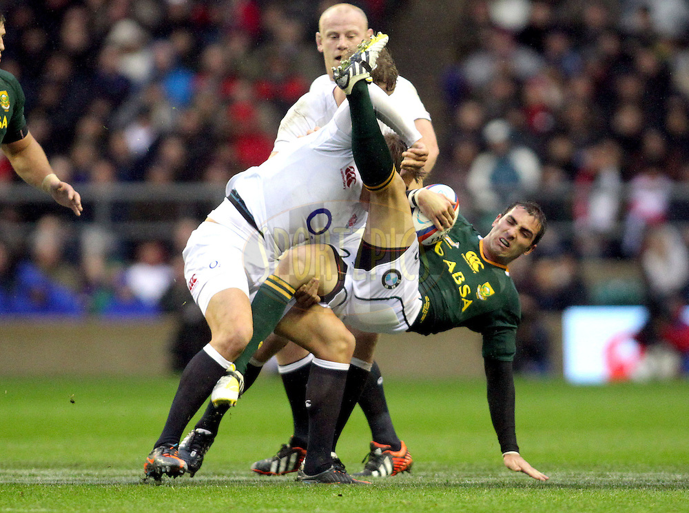 England's Toby Flood smashes South Africa's Ruan Pienaar into the air with a big tackle  England v South Africa - QBE International - 24/11/2012 - Twickenham Stadium  - London - All rights reserved...SPORTZPICS/© Andrew Fosker / Seconds Left Images 2012 -