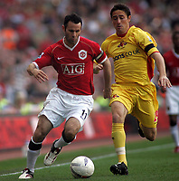 Photo: Paul Thomas.<br /> Watford v Manchester United. The FA Cup, Semi Final. 14/04/2007.<br /> <br /> Ryan Giggs (L) of Utd gets past Tommy Smith.