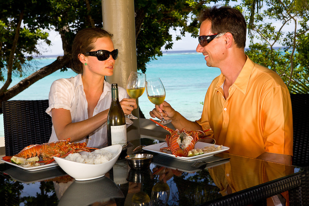 Romantic Couple Dine on Lobster and Drink Wine by the Beach, Fiji