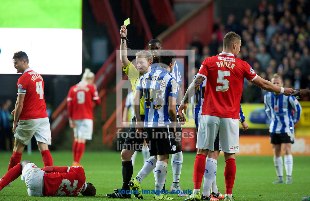 Fernando Forestieri of Sheffield Wednesday is shown the yellow card by Referee Gavin Ward for a foul on El-Hajdi Ba of Charlton Athletic (left) during the Sky Bet Championship match at The Valley, London<br /> Picture by Alan Stanford/Focus Images Ltd +44 7915 056117<br /> 07/11/2015