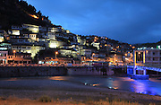 Houses of the Mangalem quarter lit up, with the bridge over the Osum river on the right, in Berat, South-Central Albania, capital of the District of Berat and the County of Berat. In July 2008, the old town (Mangalem district) was listed as a UNESCO World Heritage Site. Picture by Manuel Cohen