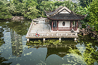 pagoda temple by pond at Kowloon Walled City Park in Hong Kong