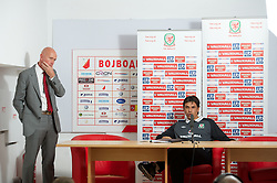 NOVI SAD, SERBIA - Monday, September 10, 2012: Wales' manager Chris Coleman and head of pubic affairs Ian Gwyn Hughes during a press conference at the Karadorde Stadium ahead of the 2014 FIFA World Cup Brazil Qualifying Group A match against Serbia. (Pic by David Rawcliffe/Propaganda)