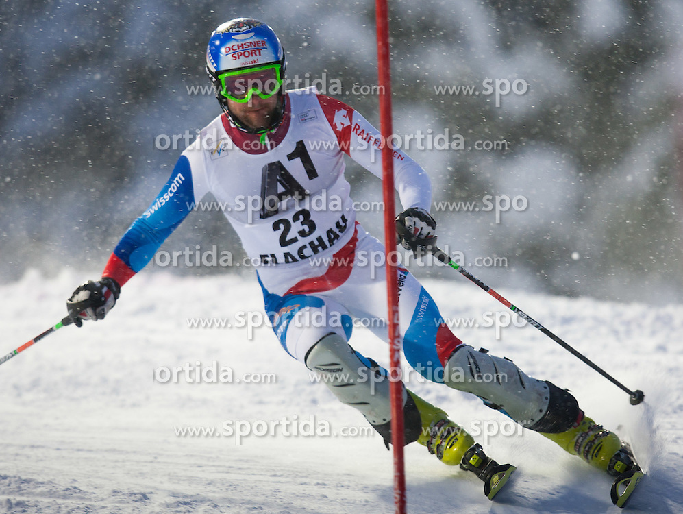 21.12.2011, Hermann Maier Weltcup Strecke, Flachau, AUT, FIS Weltcup Ski Alpin, Herren, Slalom 1. Durchgang, im Bild Markus Vogel (SUI) in Aktion // Markus Vogel of Suisse in action during Slalom race 1st run of FIS Ski Alpine World Cup at 'Hermann Maier World Cup' course in Flachau, Austria on 2011/12/21. EXPA Pictures © 2011, PhotoCredit: EXPA/ Johann Groder