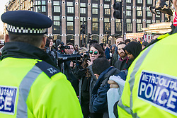 "Westminster, London, January 19th 2016. Students hold an ""emergency protest"" in Parliament Square and later blocking Westminster Bridge, against the cutting of maintenance grants. ""It took just 18 MPs 90 minutes to scrap maintenance grants for the million poorest students, without a debate in Parliament in a backroom committee"" PICTURED: Police keep watch as protesters block Westminster Bridge. ///FOR LICENCING CONTACT: paul@pauldaveycreative.co.uk TEL:+44 (0) 7966 016 296 or +44 (0) 20 8969 6875. ©2015 Paul R Davey. All rights reserved."