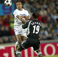 Fotball<br /> Semifinale UEFA-cup 2003/04<br /> Olympique Marseille v Newcastle<br /> 6. mai 2004<br /> Foto: Digitalsport<br /> NORWAY ONLY<br /> <br /> STEVE MARLET (OM) / TITUS BRAMBLE (NEW)