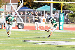 12 October 2013:  Michael Kelley kicks off, Adam O'Grady rushes during an NCAA division 3 football game between the North Park vikings and the Illinois Wesleyan Titans in Tucci Stadium on Wilder Field, Bloomington IL