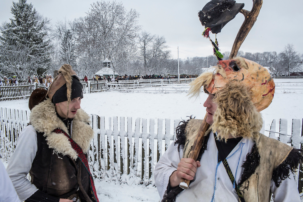 Revelers in the costumes of old men celebrate the Malanka Festival on Thursday, January 14, 2016 in Krasnoilsk, Ukraine. The annual celebrations, which consist of costumed villagers going in a group from house to house singing, playing music, and performing skits, began the previous sundown, went all night, and will last until evening.