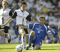 Photo: Aidan Ellis.<br /> Preston North End v Cardiff City. Coca Cola Championship. 09/09/2006.<br /> Cardiff's Ricardo Scimeca battles with Preston's Adam Howland