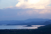 A view across a great expanse of rainforest to a mountain and lake, Arba Minch, Ethiopia