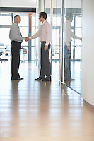 Two Businessmen Meeting in Corridor