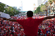 thousands of Red shirts (UDD protesters) block Downtown Bangkok while heavy security wait for action on Sunday, April 4th 2010. Most malls and shops have closed down while protests are getting larger during the 2nd day of demonstration in the center of the capital.