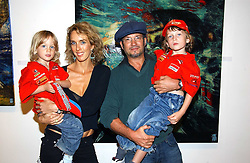 Artist ADAM BRICUSSE, his wife SARAH and their children, left LUCA and right ROMAN at a private view of artist Adam Bricusse's paintings entitles 'The Mysteries Within' held at the Charing X Gallery, 121-125 Charing Cross Road, London WC2 on 12th September 2006.<br />