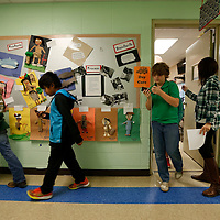 "Thomas Wells | Buy at PHOTOS.DJOURNAL.COM<br /> Students begin to pour put of Krista Weems' classroom with their heads down focused on their mp3 players with that day's lesson palying as they begin their ""walking classroom"" around Saltillo Elementary."