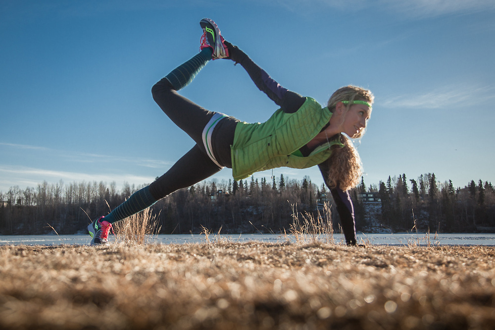Desiree Bax performs the Partridge Pose before a run at Westchester Lagoon, Anchorage