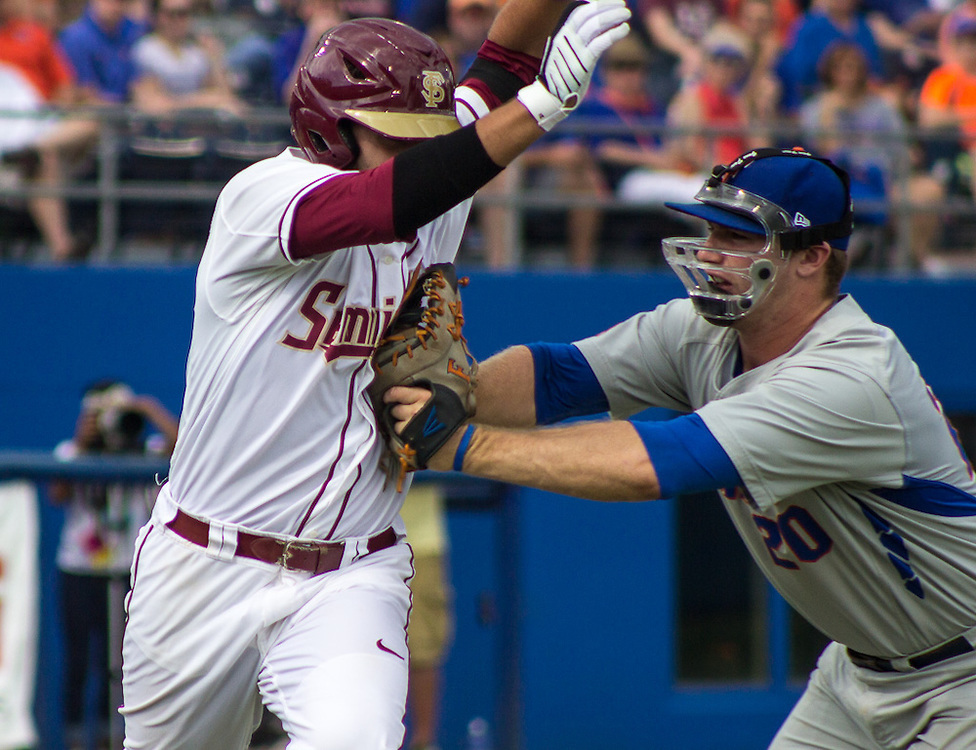 Florida first baseman Peter Alonso puts runner John Sansone out in the first-inning of the Gainesville Super Regional, Saturday, June 6, 2015. (photo by Samuel Navarro)
