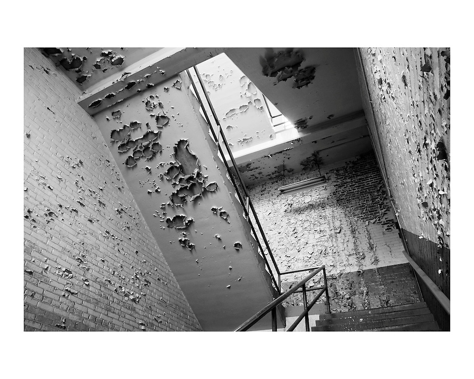 North Stairwell, Cobb Warehouse, 2006.Once the climate controls inside Cobb Warehouse were turned off, the paint quickly began to peel from the walls inside the four-story structure. The $150 million dollar historical restoration and renovation of  the Liggett & Myers factory complex by Blue Devil Partners is considered to be one of the most ambitious in North Carolina history.   The L&M factory complex is listed on National Registry of historical places and Blue Devil Partners has worked closely with the State Historic Preservation Office and the National Park Service to ensure the expansion project will meet their specific guidelines for a true restoration project.