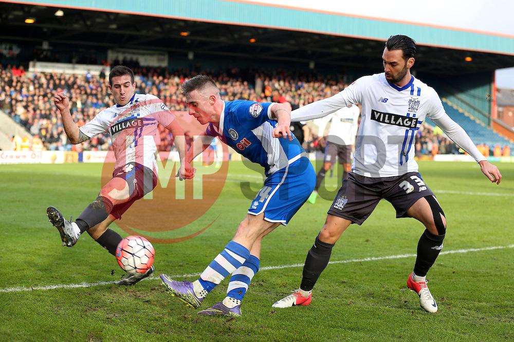 James Hooper of Rochdale crosses the ball under pressure from Craig Jones Chris Eagles of Bury   - Mandatory byline: Matt McNulty/JMP - 06/12/2015 - Football - Spotland Stadium - Rochdale, England - Rochdale v Bury - FA Cup