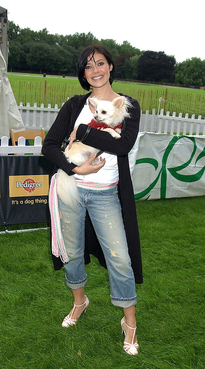KYM MARSH and her dog Charlie at the 3rd annual Macmillan Dog Day in aid of Macmillan Cancer Relief held at Royal Hospital Chelsea, London SW3 on 5th July 2005.<br />