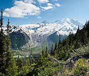 Mount Rainier, Emmons Glacier, and the headwaters of the White River are seen from trails out of Sunrise in Mount Rainier National Park, Washington. For vigorous trailing, hike the Burroughs Mountain 10 mile loop, 3200 feet ascent, from White River Campground up Glacier Basin Trail, back via Shadow Lake.
