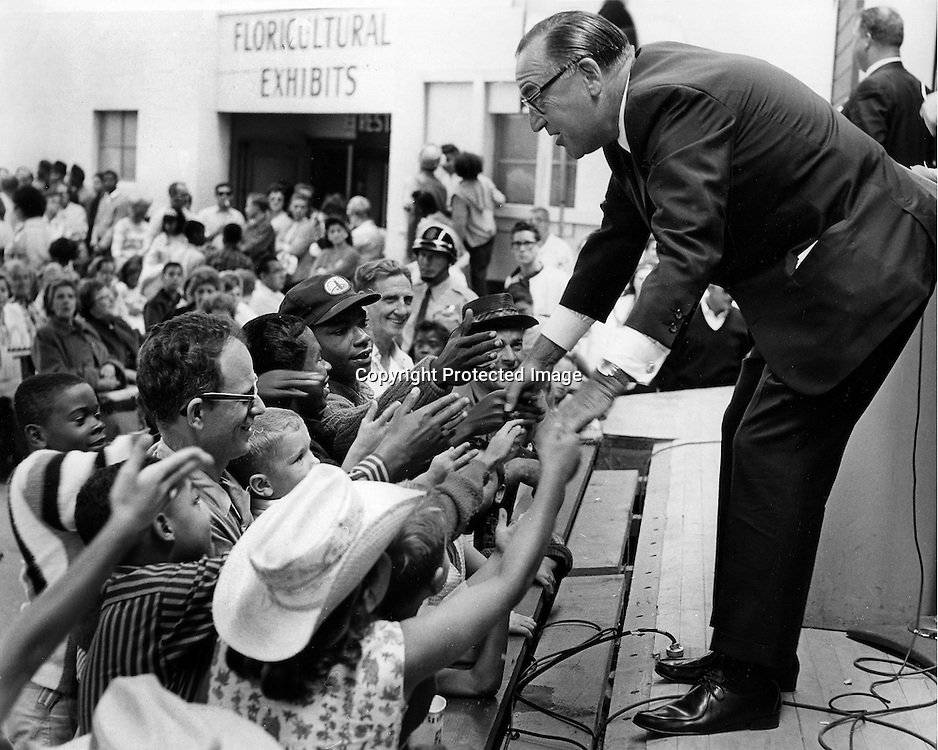 "California Governor Edmund G.""Pat"" Brown shaking han ds at Labor Day 1965 (photo by Ron Riesterer)"