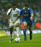Photo. Andrew Unwin<br /> Leeds United v Birmingham City, Barclaycard Premier league, Elland Road, Leeds 20/09/2003.<br /> Leeds' Jermaine Pennant (l) holds off Birmingham's Stan Lazaridis (r).