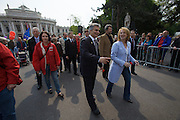 Maiaufmarsch (Labour Day March) of the SPOE (Social Democratic Party of Austria). Delegations from all of Vienna's districts arriving at the Rathaus (City Hall), here Austrian Chancellor Werner Faymann with his home district Liesing (Nr. 23), accompanied by Doris Bures (Minister of Infrastructure).