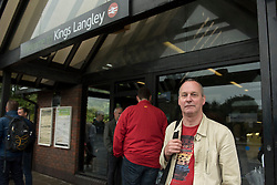 © Licensed to London News Pictures. 16/09/2016. Watford, UK.  Michael Clarke from Berkhamstead is amongst the passengers waiting to be collected outside Kings Langley rail station following the derailment by a landslide of a train bound for London Euston. They were transferred from the derailed train to a rescue train and exited at Kings Langley.  Apart from one person who suffered whiplash, there were no other reported injuries. Photo credit : Stephen Chung/LNP