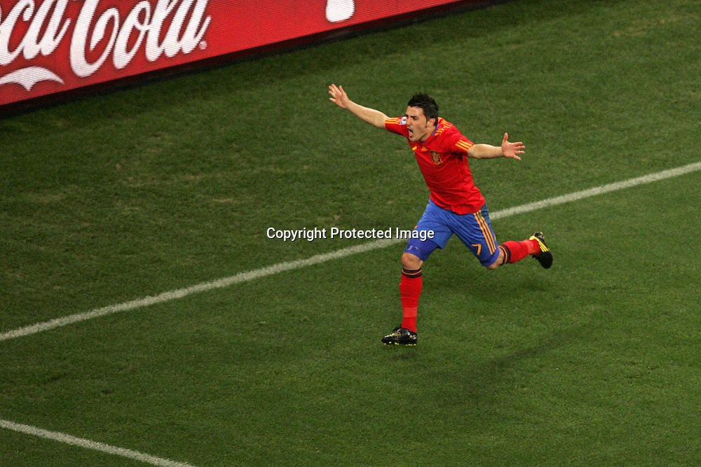 David Villa of Spain celebrate the first goal for Spain during the FIFA World Cup 2010 last 16 match between Spain and Portugal held at The Cape Town Stadium in Green Point, Cape Town, South Africa on the 29th June 2010<br /> <br /> <br /> Photo by Ron Gaunt/SPORTZPICS