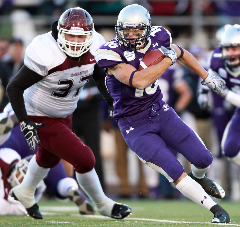 University of Western Mustangs running-back Kenny Eansor eludes a tackle from  Roberto Filice of the McMaster Marauders  during the Mustang's 34-28 victory over the Marauders in the OUA semi-Final at TD Waterhouse Stadium in London, Ontario, November 6, 2010.<br /> <br /> The Canadian Press/GEOFF ROBINS