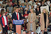Republican presidential candidate billionaire Donald Trump introduces his daughters Ivanka, right, and Tiffany and son Barron, left, during a campaign rally at the Myrtle Beach Convention Center November 24, 2015 in Myrtle Beach, South Carolina.